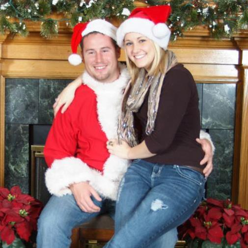 My older brother, Greg, is dressed like Santa, and, his fiance, Chelsey, sits on his lap. Welcome to the family@