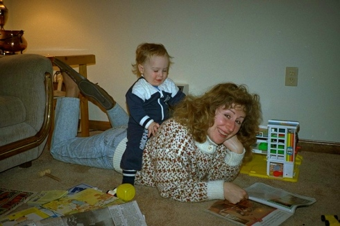 My mom reading with my older brother on her back. She loved her family and her books.