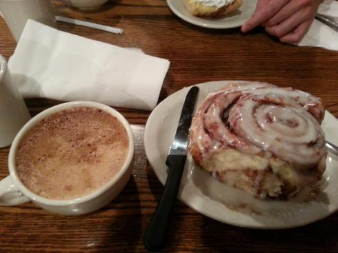 I also share funny things on my Twitter about my every day life: This is a giant cinnamon roll I ate! It came with a steak knife. How awesome is that?