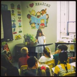 Little Shannon reading her first book to her elementary class. (I bet I reevaluated myself back then, too.)